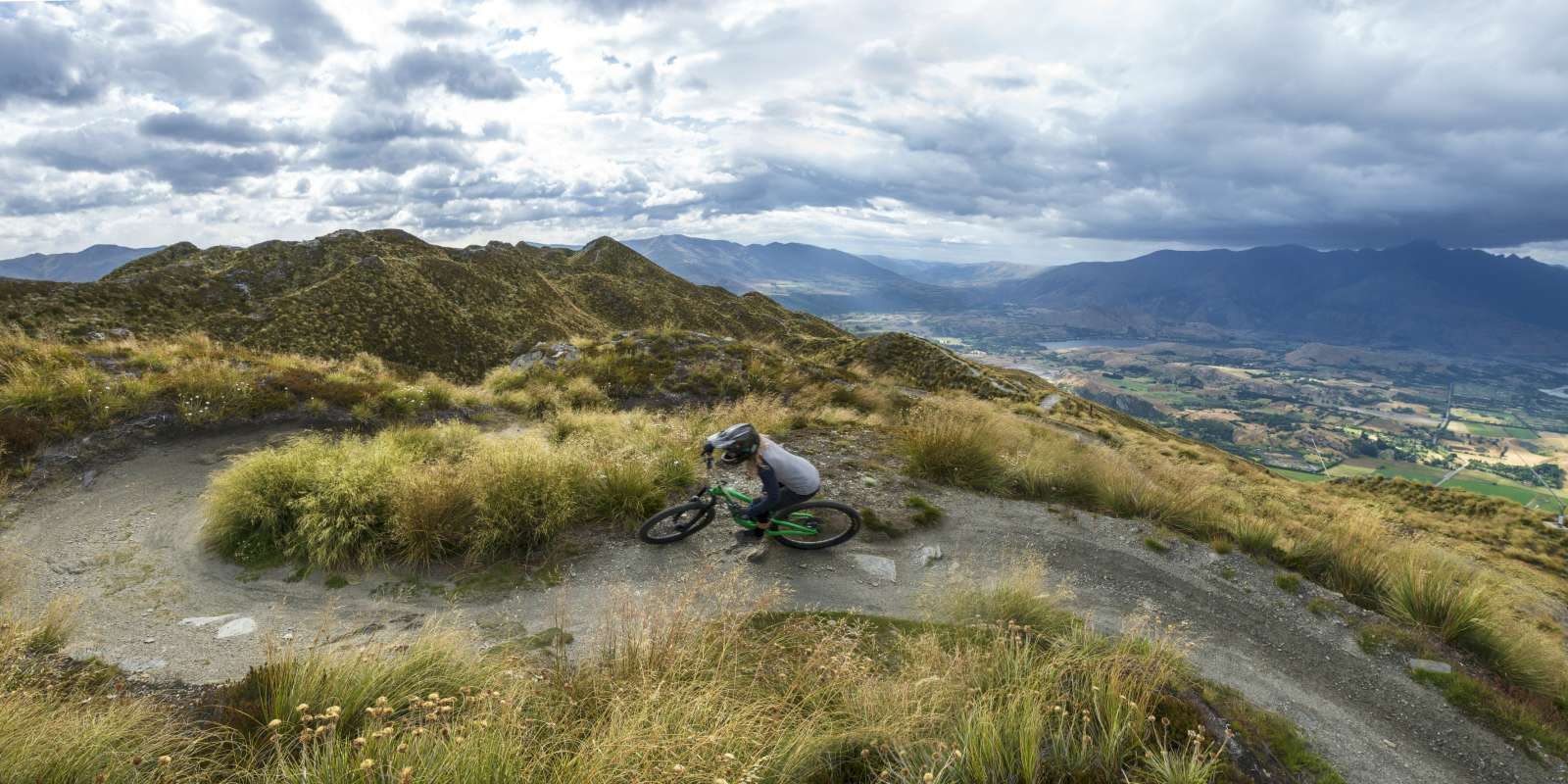 Woman Mountain Biking at Coronet Peak in Summer