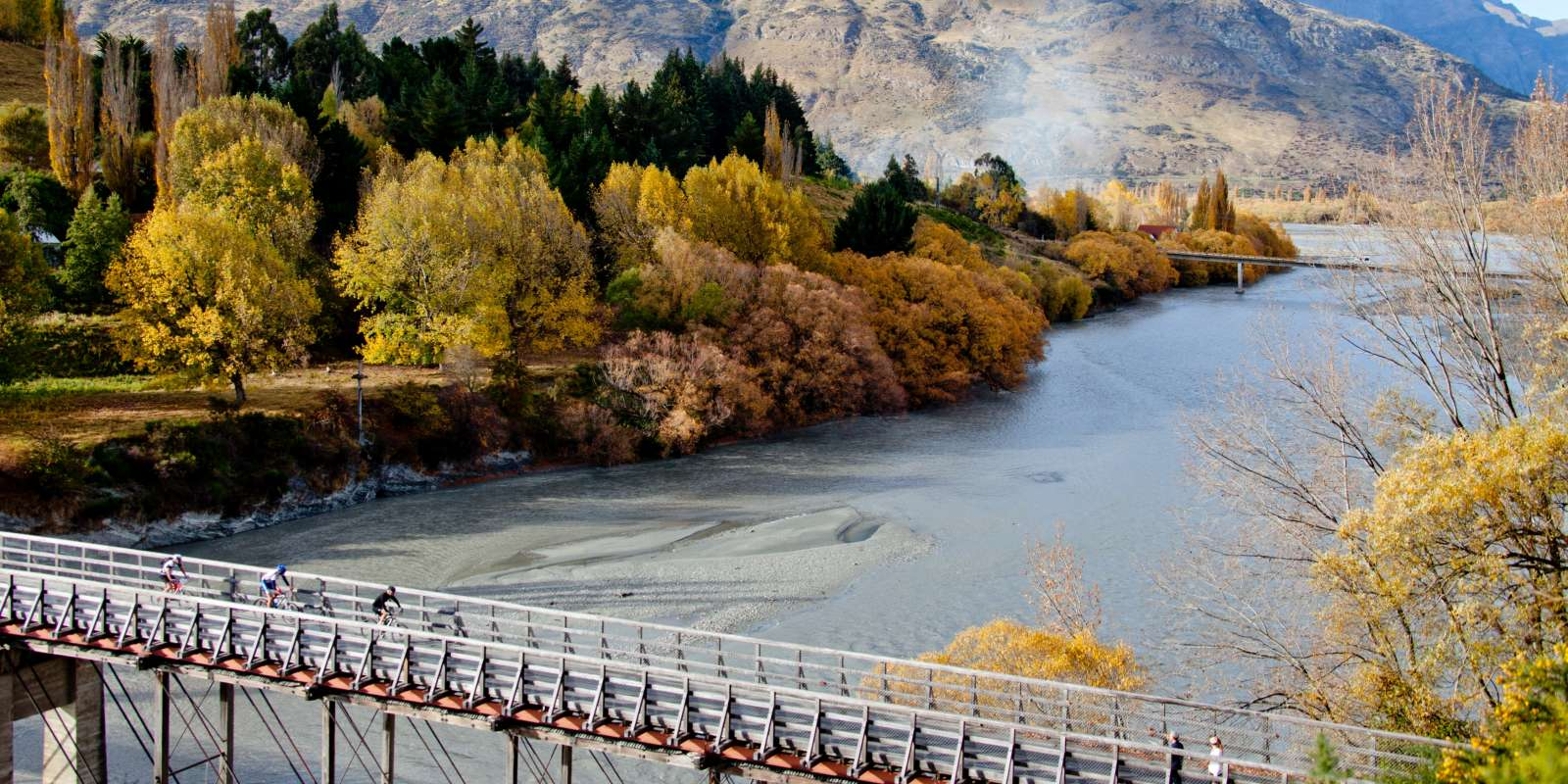 ebiking in queenstown going over the old shotover bridge riding from queenstown to arrowtown