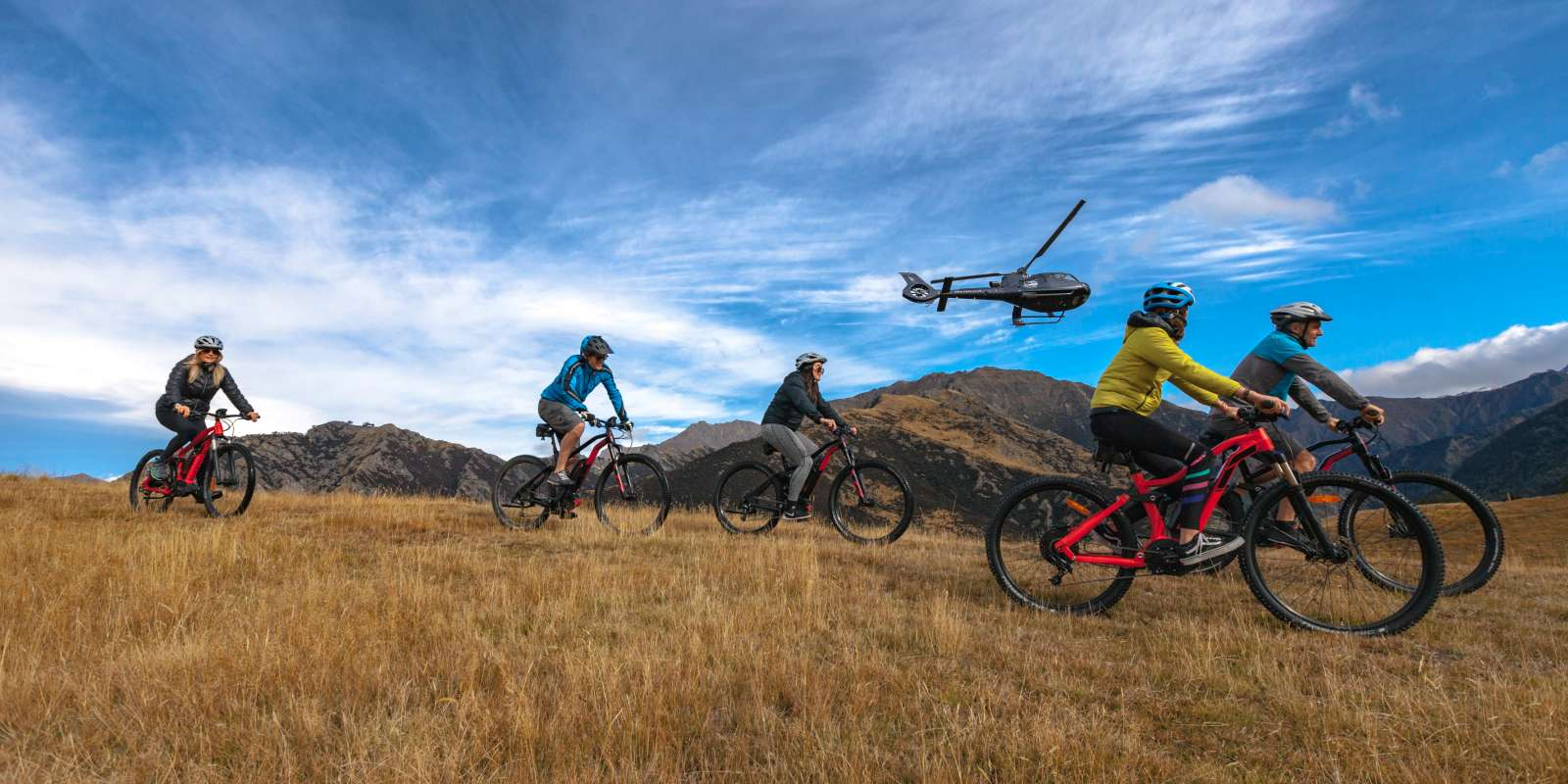 join a heli-ebiking adventure combining the thrill of a helicopter ride with riding in a high country farm