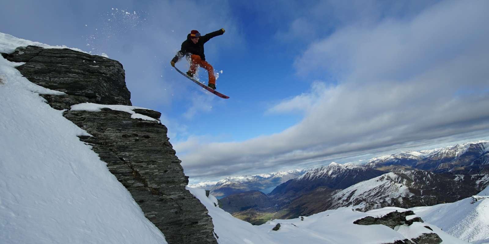 Snowboarder getting air at Coronet Peak