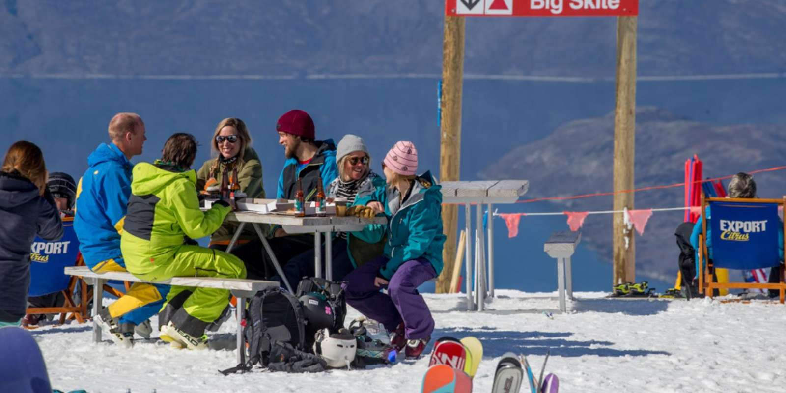 Friends having drinks and food at Treble Cone Ski Area