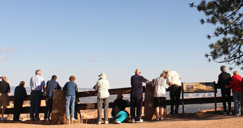 International visitors share the railing on the rim at Bryce Canyon