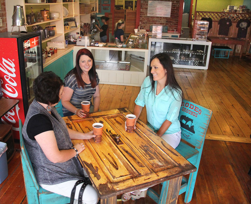 Women enjoy drinks at a Panguitch Utah coffee shop and bakery.