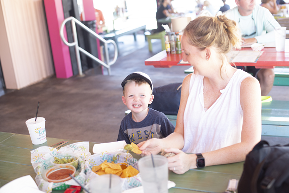 Mother and son eating at Lucy Buffet's Lulu's