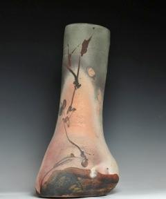 Vase is by Paul Soldner at Haan Mansion