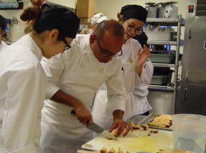 A Chef at John Purdue Room plating scrumptious delights!