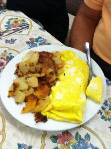 Omelet and fried potatoes