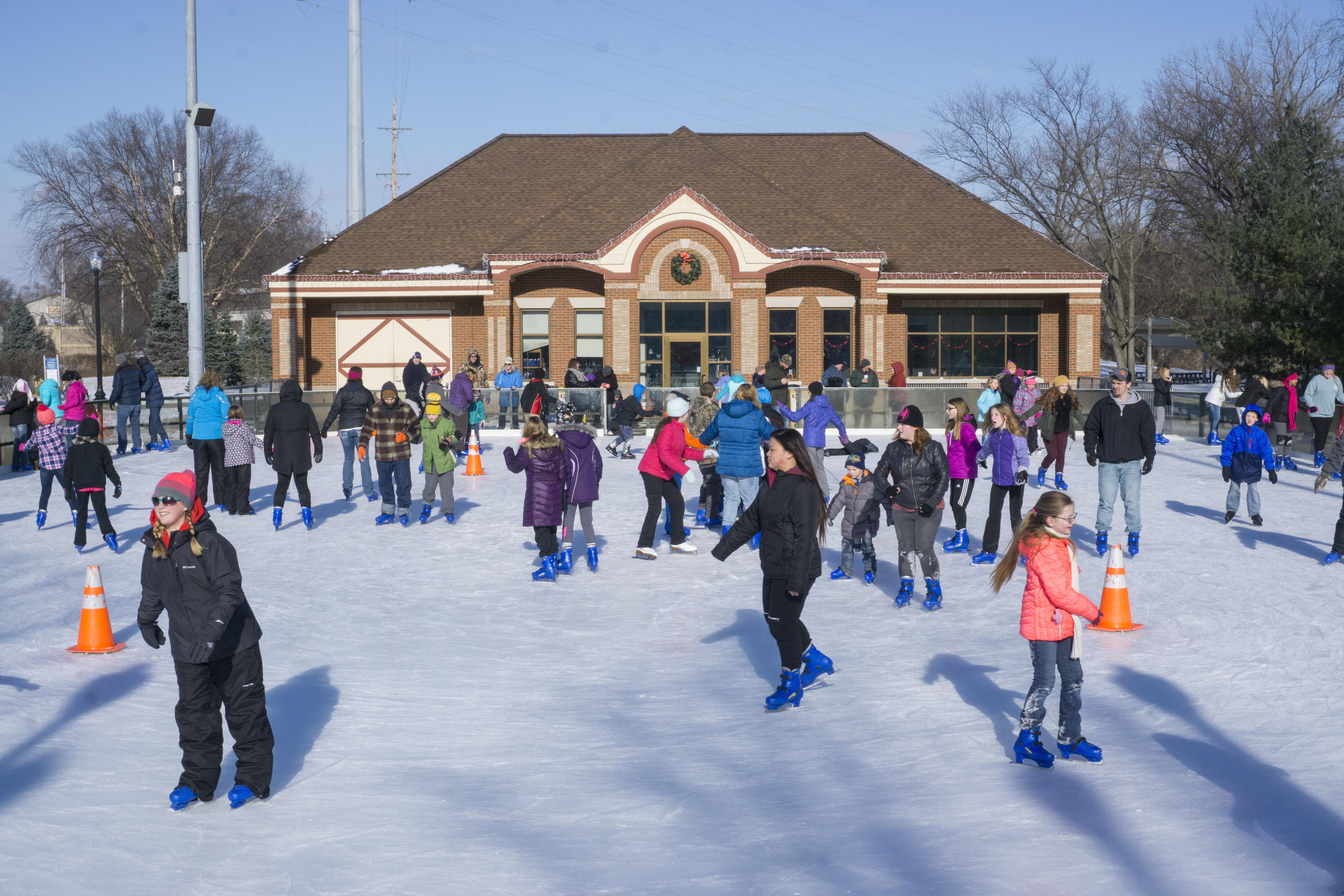 Could you ice skate in a swim suit? These skaters have the right of it wearing full outdoor winter gear!
