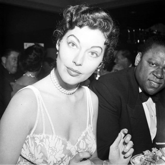 Ava 1952 Photoplay Awards LA next to William Warfield who was Ol' Man River in Show Boat eyebrows