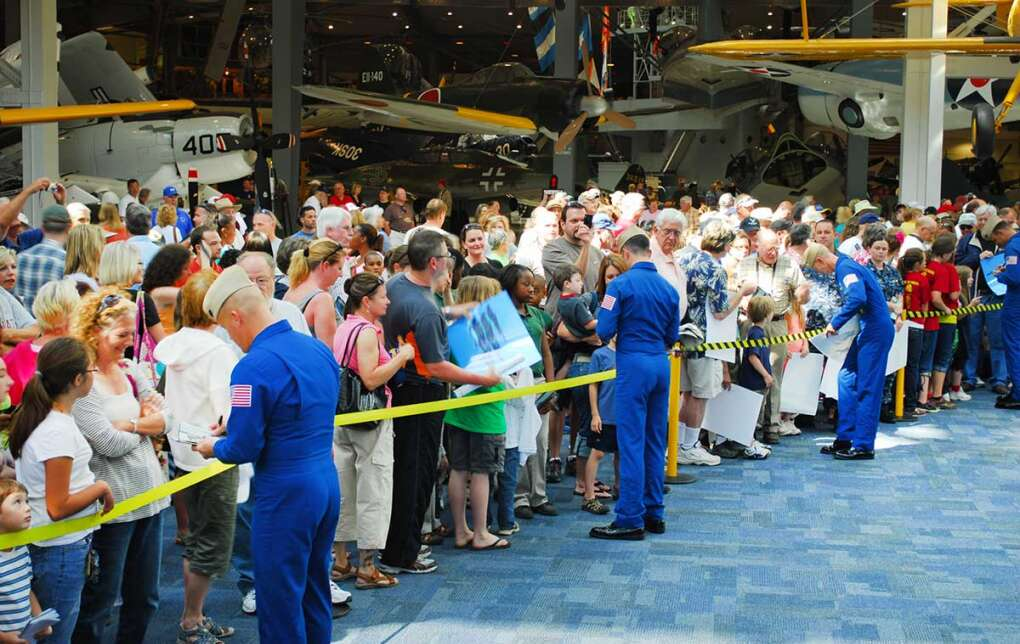 The Blue Angels, the U.S. Navy's flight demonstration squadron, practice and sign autographs at the National Naval Aviation Museum.