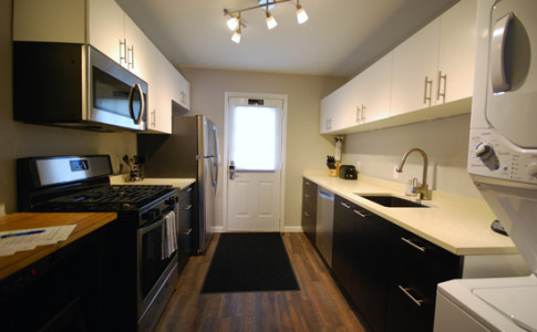 Brookwood-Courtyard-Condos-Complete-Galley-Kitchen-with-Full-Size-Appliances-by-BCA-Residential-Furn