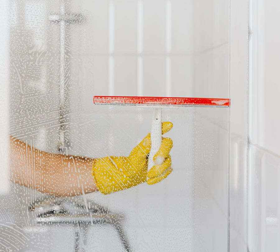 alt-text crop-person-cleaning-glass-shower-unit-4239091