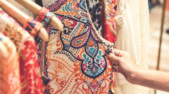 shallow-focus-photography-of-assorted-color-clothes-hanged-1078958