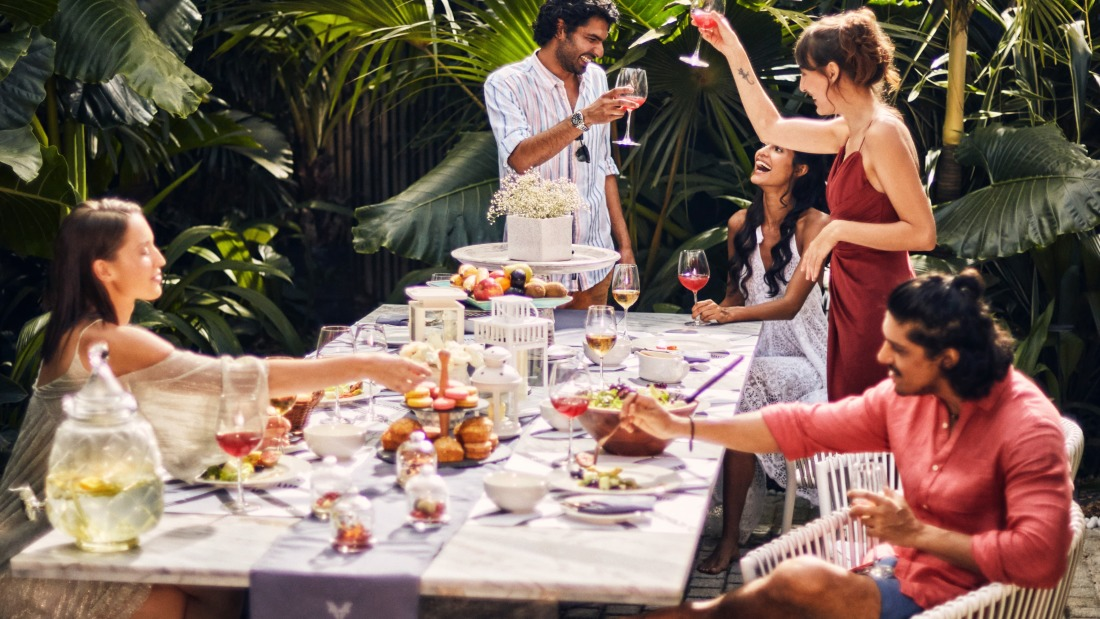 People celebrating and eating at the luxury villa with staff in Goa - Villa in Palms by V Escapes