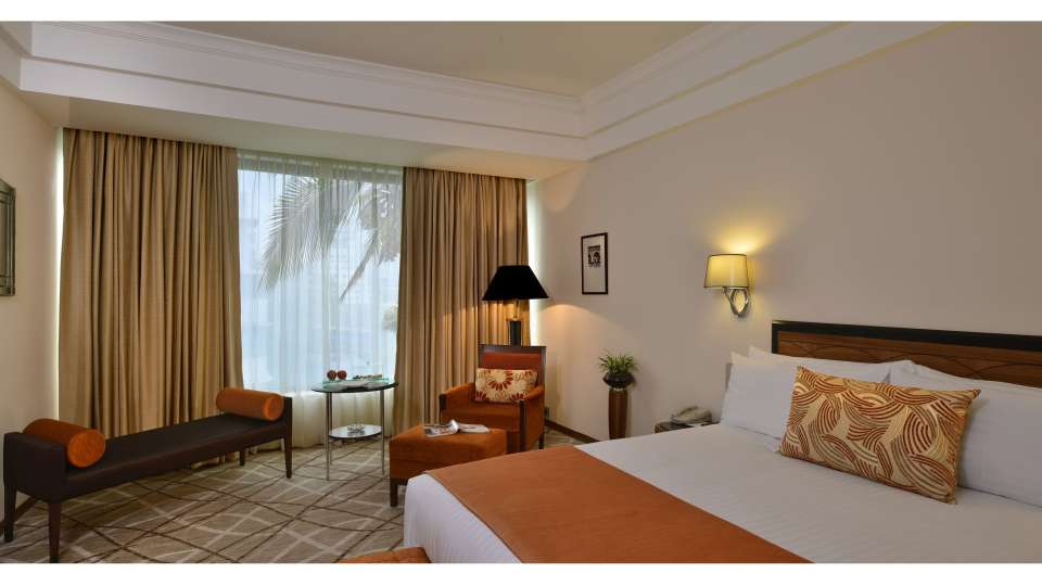 Deluxe suite bedroom at Hotel Marine Plaza Mumbai
