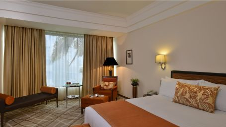 Deluxe suite bedroom at Hotel Marine Plaza Mumbai