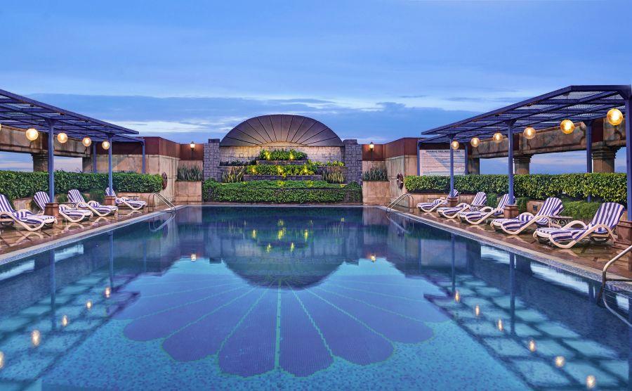 alt-text Swimming Pool at The Bristol Hotel, Gurgaon, 5-star hotel in Gurgaon