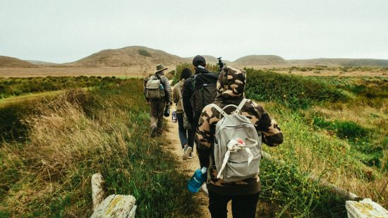 people-walking-on-trail-3002082 1