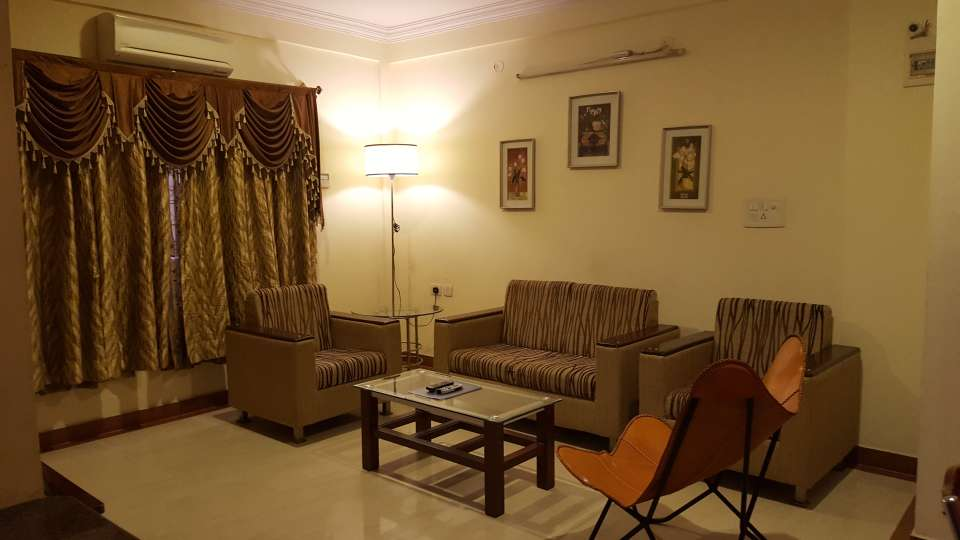 Maple Suites Serviced Apartments, Bangalore Bangalore one BHK living area 1