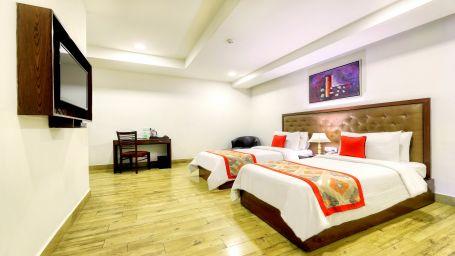 Twin Standard Room at Taurus Sarovar Portico New Delhi1