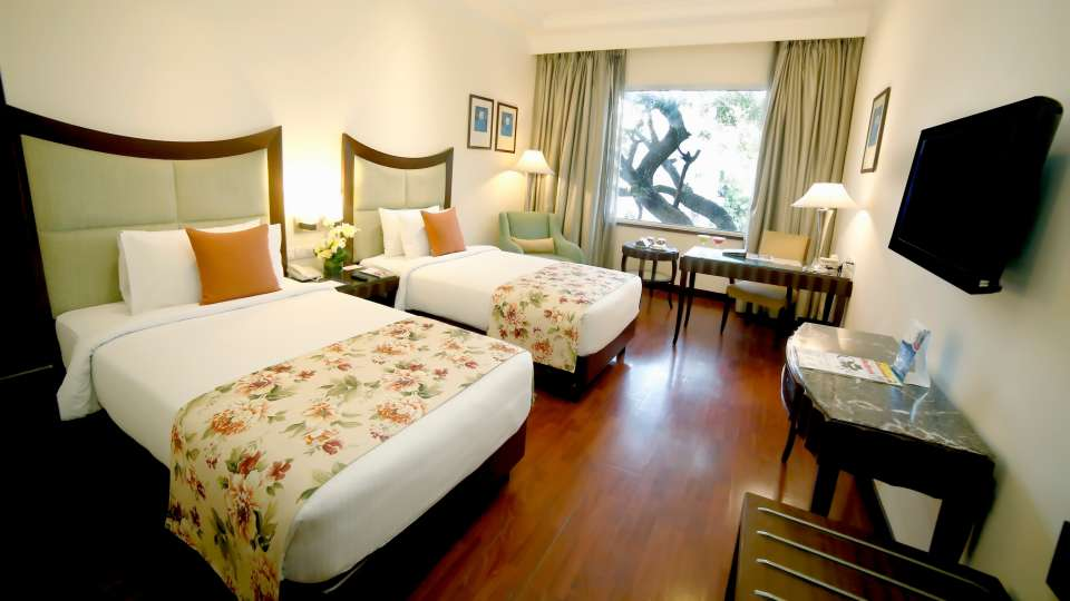 Deluxe Rooms at Muse Sarovar Portico Hotel in Delhi 1