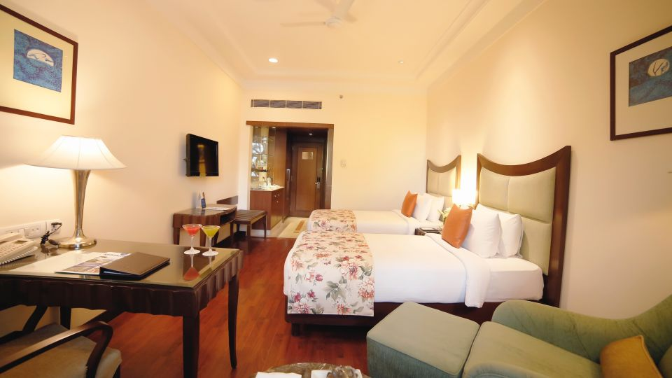 Deluxe Rooms at Muse Sarovar Portico Hotel in Delhi 2