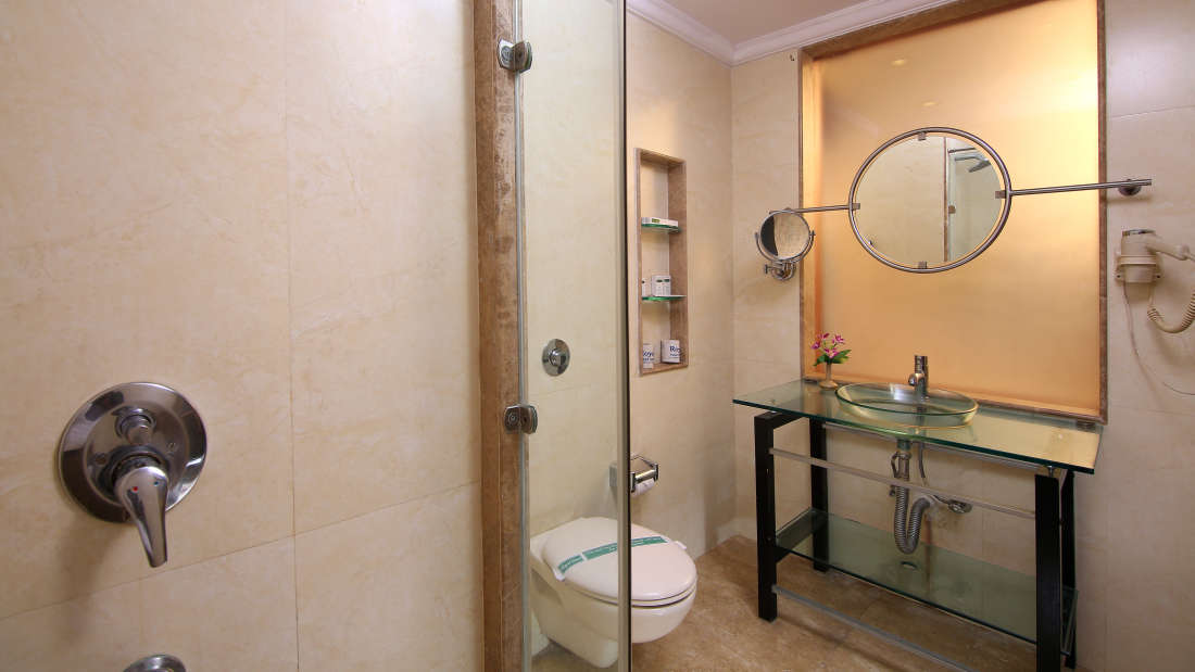 Bathroom with Vanity Basin and Mirror Hotel Royal Court Madurai Best Budgetg Rooms in Madurai