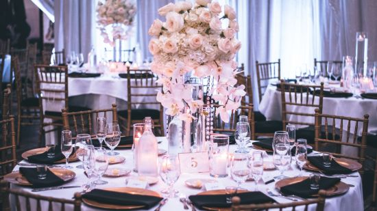 pink-and-white-roses-centerpiece-on-top-of-table-1616113 1