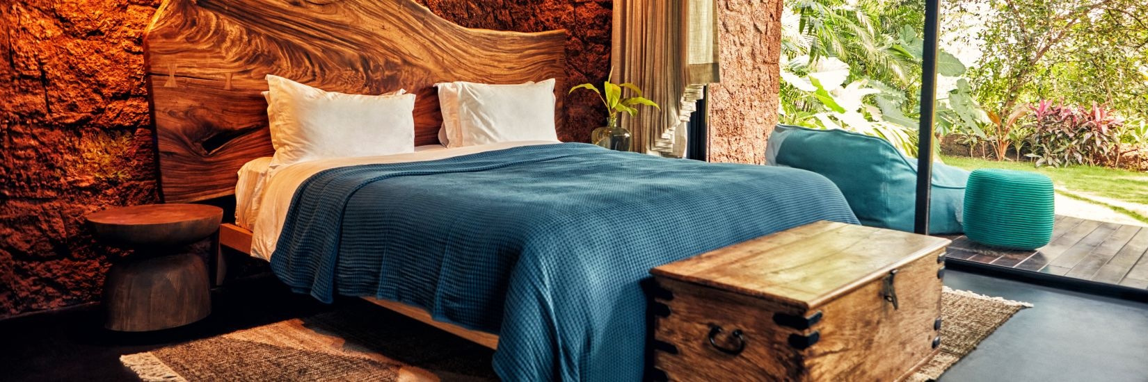 King size bed with blue covers at the private villa in Goa - Villa in Palms by Vescapes