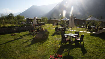 Outdoor Dining Area at Larisa Mountain Resort in Manali - Hotels In Manali