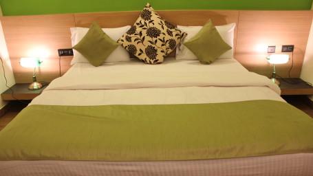 Hotel Arama Suites Bangalore bedroom aura suite 2 hotel arama suites bangalore