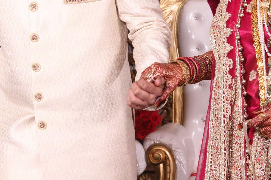 alt-text Canva - Indian Wedding Couple