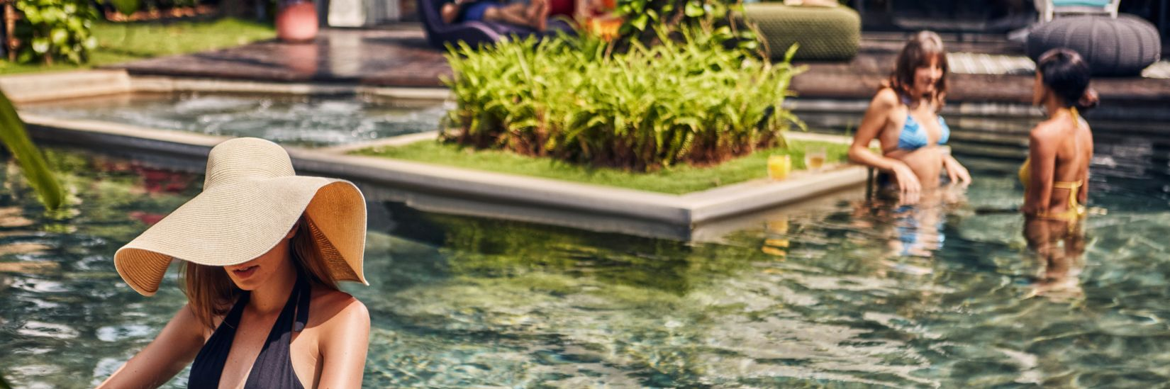 People relaxing in the clear waters of the Goa villa with private pool - Villa in Palms by Vescapes