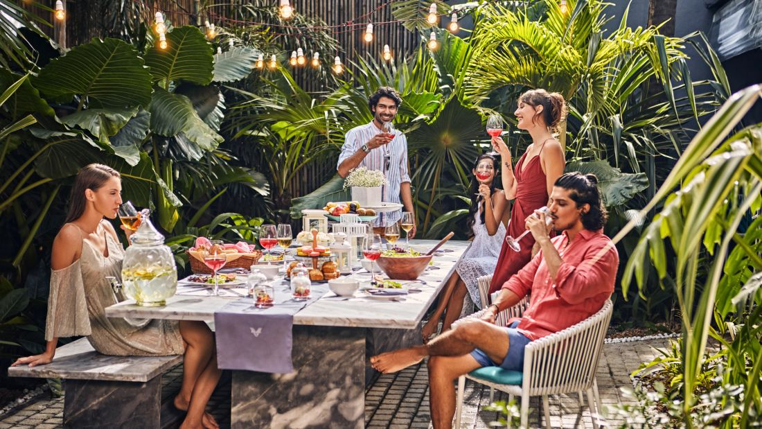 Guests drinking and eating at the luxury villa with chef in Goa - Villa in Palms by Vescapes