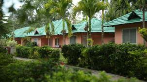Palm Era Cottages, Coorg Coorg facade palm era cottages coorg resort 6