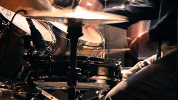 Canva - Man Performing Drum
