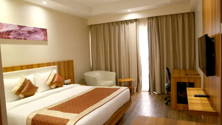 Le ROI Hotels & Resorts  Premium Golden Room at Le ROI Udaipur Hotel