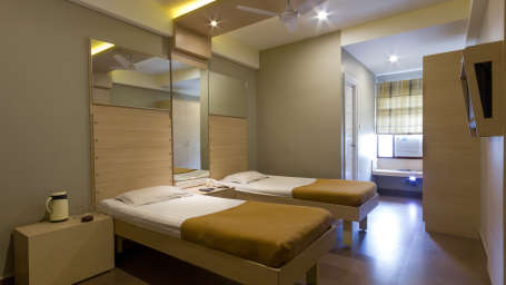 Comfort Deluxe AC Rooms at Hotel Sandhya Residency Bangalore