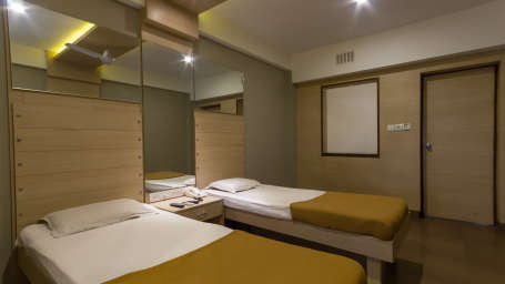 Comfort Deluxe Rooms at Hotel Sandhya Residency Bangalore