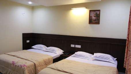 The Signature Inn Hotel, Bangalore Bangalore Deluxe Four Bed Non Ac Room The Signature Inn Hotel Bangalore