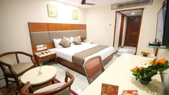 King-sized bed at Hotel Daspalla Executive Court Vishakapatnam 1