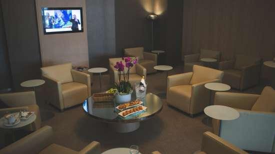 white-sofa-chairs-near-tv-2612117