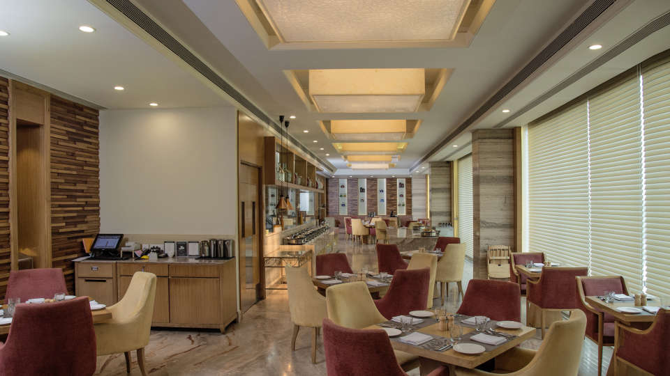 Dining area at efcee sarovar portico hotels in bhavnagar