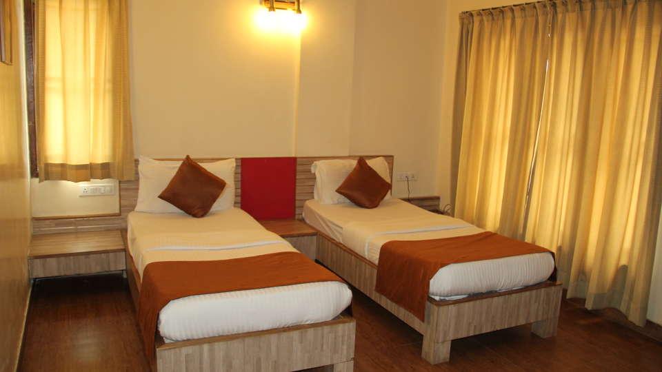 Hotel Arama Suites Bangalore twin beds aura suite 1 hotel arama suites bangalore