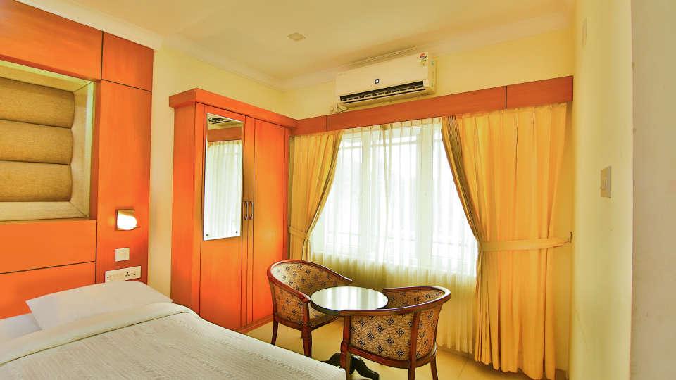 Triple Deluxe Rooms, Hotel Sree Gokulam Vanamala, Stay in Guruvayur 1