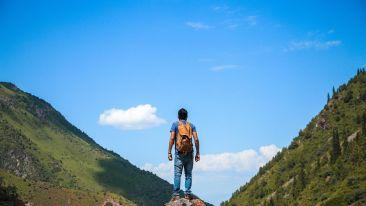 man-on-top-of-mountain-840667