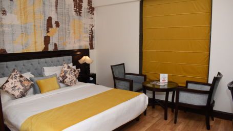 King size bed in Club Deluxe room of Hotel Gargee Grand