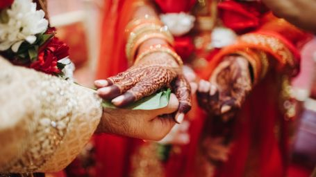 ritual-with-coconut-leaves-during-traditional-hindu-wedding-ceremony