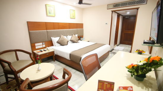 King-sized bed at Hotel Daspalla Executive Court Vishakapatnam 1