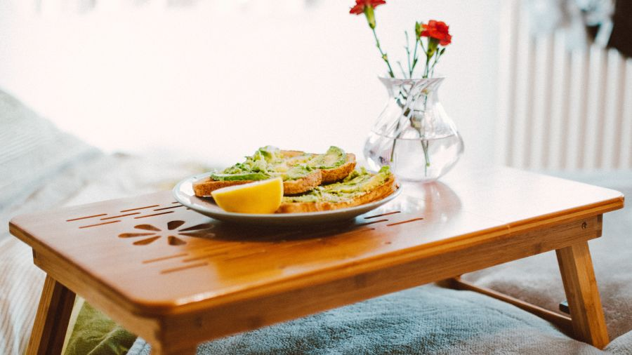 food-on-plant-on-wooden-bed-tray-1843244